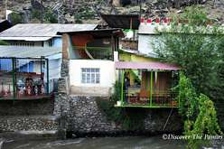Guesthouse over a river in Darvaz